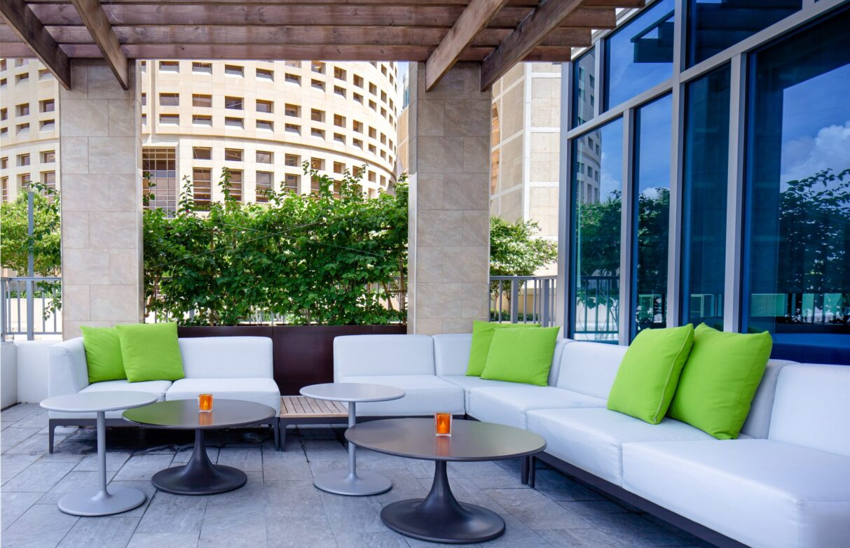 The outdoor seating area by the pool at Aloft Downtown Tampa